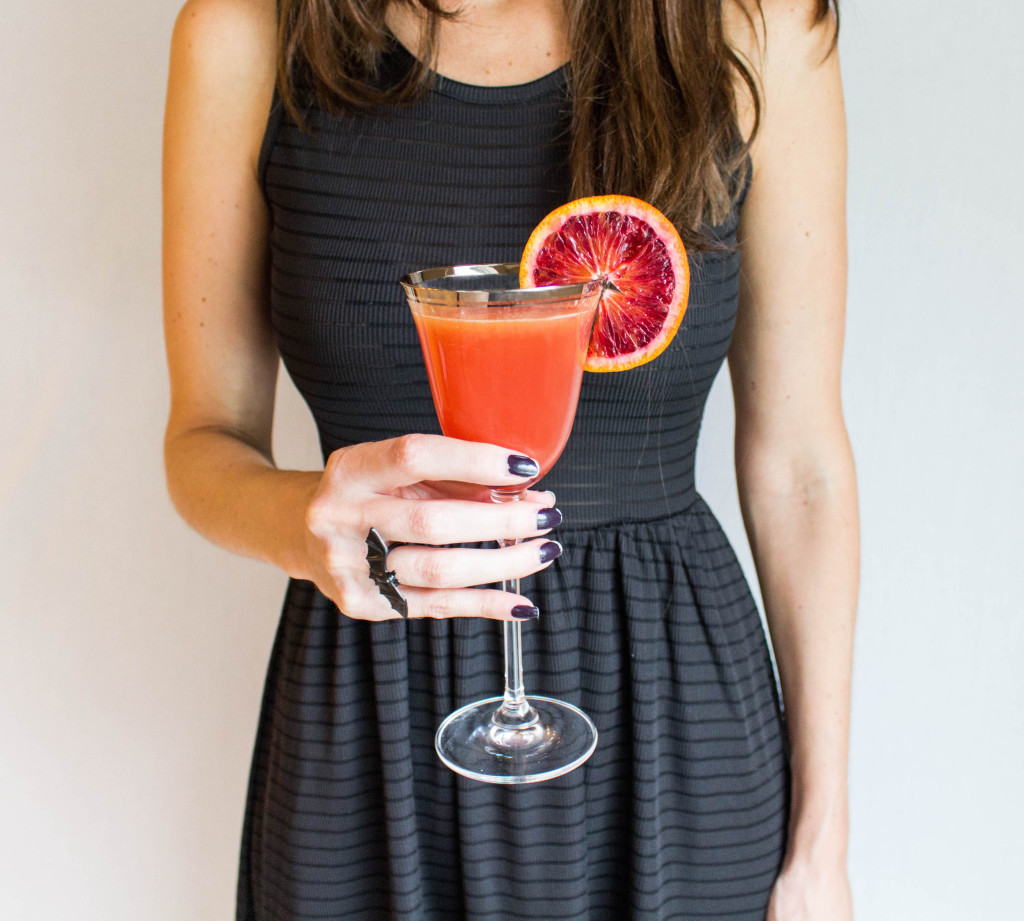 Blood orange cocktail and champagne flute photo