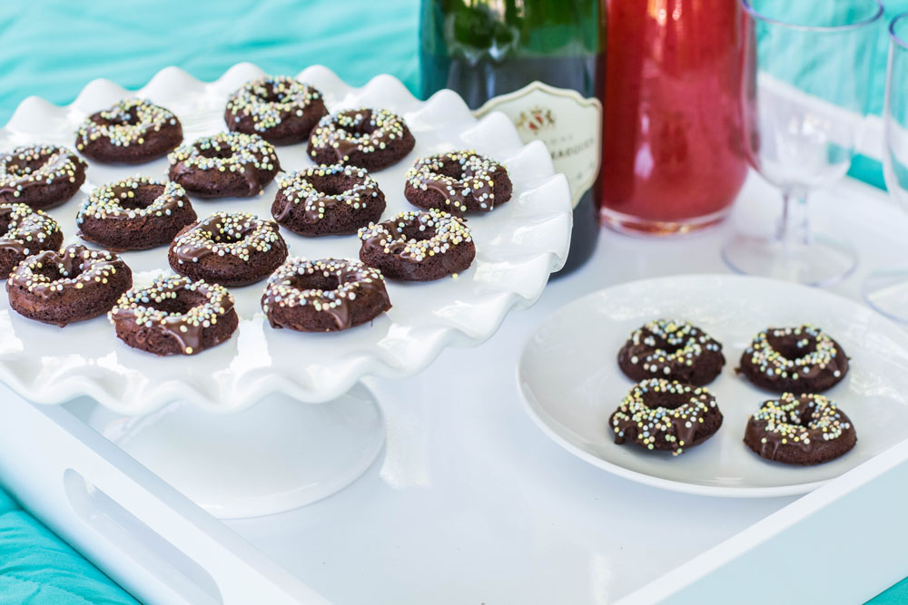 mini chocolate donuts with sprinkles on tray