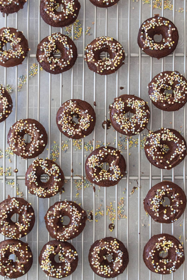 Mini Donuts with sprinkles on cooling rack