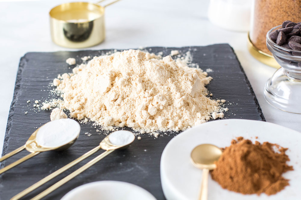 Almond flour with gold measuring spoon
