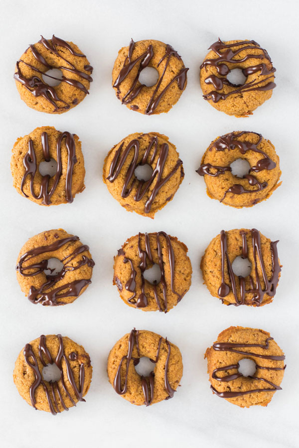 Detail of Gluten-Free Mini Pumpkin Donuts with chocolate drizzle