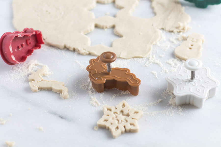Christmas cookie cutouts with dough