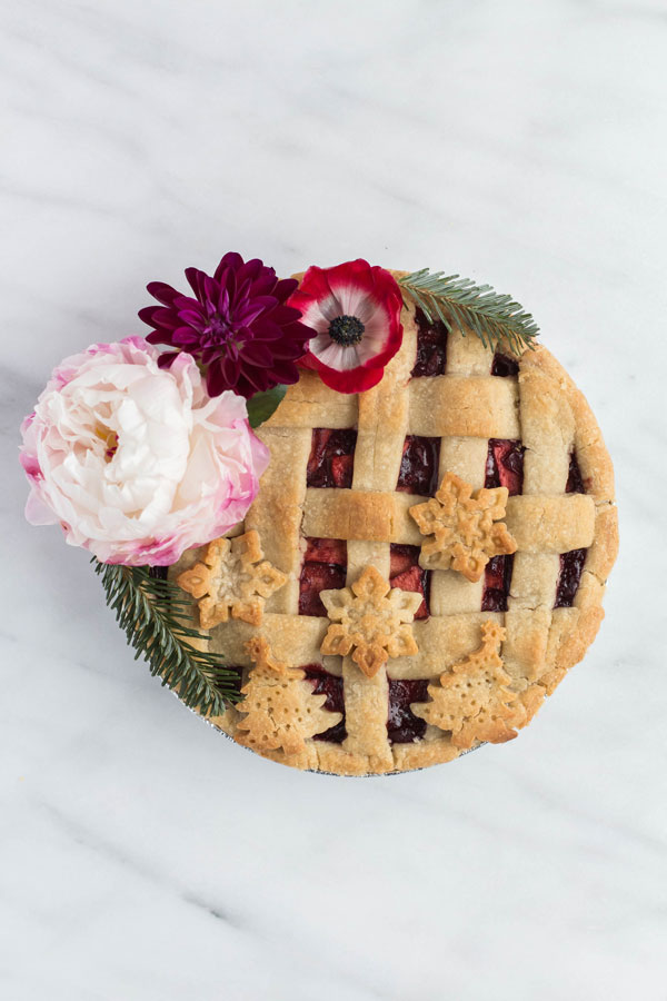 lattice top Christmas pie with holiday pie cutouts and flowers